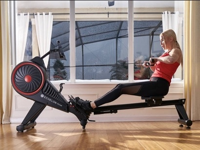 a woman does an on demand workout on the Echelon Smart Rower