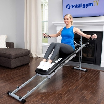 a woman uses the Total Gym